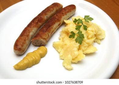 german sausage with mustard and potato salad