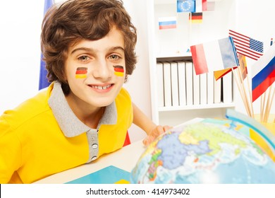 German schoolboy learning geography at the class