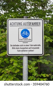 German sign that says: Attention car drivers. You are in a bicycle road. Pay attention to cyclists.