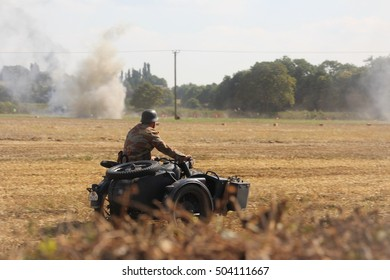 German soldier re-enactor riding motorcycle and side car,  world war two history reenactment  at Cosby air show , England 2014