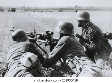 German soldiers fire a machine gun during the Nazi invasion of the Soviet Union (Russia). Summer 1941, during World War 2.