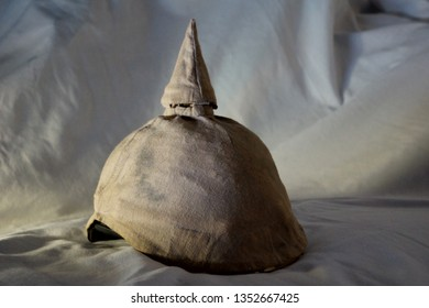 A German spiked helmet from World War I. This fierce looking Pickelhaube was worn in the early years of the Great War by soldiers of the German Army at the front. It is leather covered with linen.