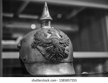 GERMAN SPIKED PRUSSIAN HELMET.first world war.helmet of the 19th century on gray background. inscription: mit Gott fur Koenig und Vaterland -with god for king and fatherland