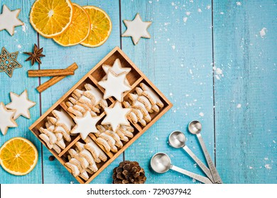German Star Cookies in a gift box with spices and dried oranges over a light blue background.  Christmas or Yom Kippur.