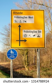 German street sign with direction signs. Location: Germany, North Rhine-Westphalia, BorkenCity: Rhede, recreation area Pröbsting lake West and East. Text in German