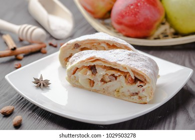 German strudel with apples,strudel with almonds and apples and raisins,home-made strudel,homemade baking