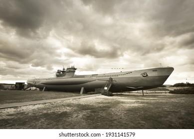 German submarine U-995. Dramatic sky, storm clouds. Museum ship, Laboe Naval Memorial. Germany. Panoramic view, sepia image effect. Landmarks, sightseeing, history, past, war, WW2, nautical vessel - Shutterstock ID 1931141579