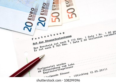 German tax bill in a studio shot, the text (no personal informations) tells how much tax has to be paid