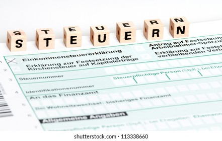 German tax form with selective focus in front of a white background, Steuern means tax