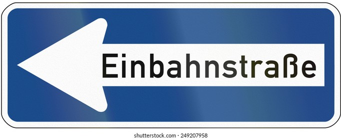 German traffic sign: Einbahnstrasse/One-way road, pointing to the left.