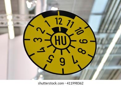 German TUV seal for car plates.
