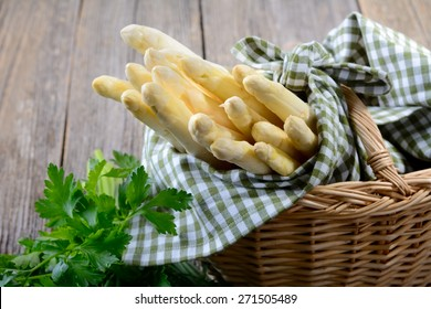German white asparagus in a basket and decorated with parsley