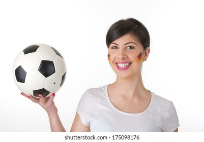 German woman fan holding the ball in her hand isolated on white
