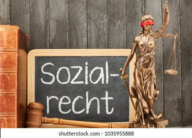 German word Sozialrecht (social law) with Justitia statue and other law symbols
