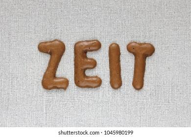 German word ZEIT (time) written with cookies