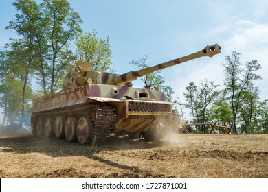 German world war II heavy tank the Tiger goes on a field with trees on the background. Nedvigovka, Rostov-on-Don region / Russia - 30 august 2013.