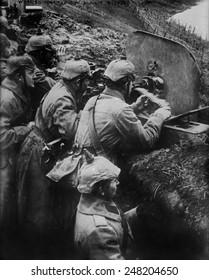 German WW1 machine gun crew firing from a trench on the Eastern Front. 1914-15.