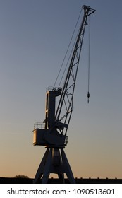 Lübeck / Germany, 05 13 2018: historic harbor crane in the evening light