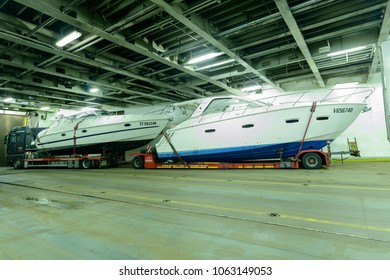 Germany , 05.04.2018 , Lübeck , A heavy goods truck with yachts is standing in the loading deck of a car ferry