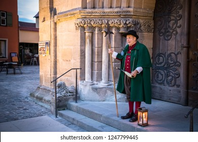 Dinkelsbühl, Germany - 10 August 2018: The night watchman of Dinkelsbühl begins his evening tour with visitors telling the story of the city.