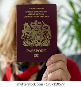 Osnabrück, Germany - 13 June 2020: woman holding red British passport
