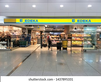Germany - 14 June 2018: front side with sign of Edeka shop supermarket inside airport, Munich Germany