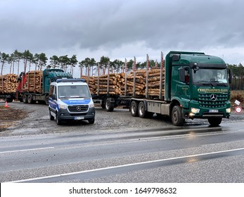 Grünheide, Germany - 19 FEBRUARY 2020: A truck carrying wood leaving the site where Tesla has been ordered to temporarily stop forest clearing (german: Rodungsstopp)