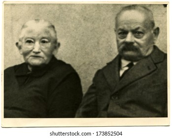 GERMANY - 1920s: An antique photo shows studio portrait of an elderly couple