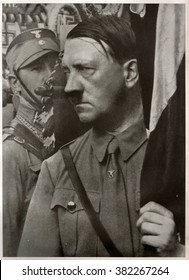 GERMANY - 1935:  Adolf Hitler holds a standard during the Party Congress of the NSDAP in Weimar Republic.  Reproduction of antique photo.