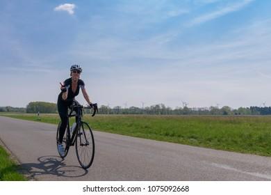Germany, 21.04.2018, Lübbenau, cyclist on her own at the Spreewald Marathon