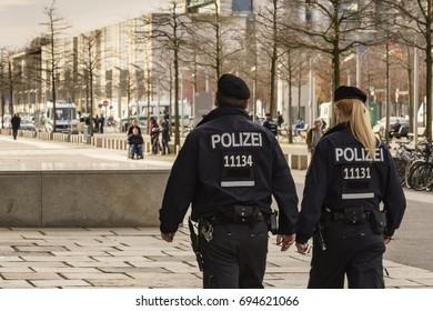 Germany , 22.03.2017 , Berlin , A male policeman and a female policewoman in the Berlin government quarter on patrol