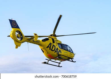 Germany , 22.08.2017 , Lübbenau , Rescue helicopter of ADAC, Christoph 33 before blue sky after the start