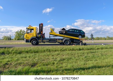 Germany , 26.04.2018 , Lübben , After an accident the car is towed onto a tow truck