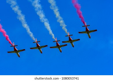 Germany, 29.04.2018, Berlin, ILA, Spanish aerobatic team in the sky with coloured plumes of smoke