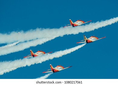 Germany, 29.04.2018, Berlin, ILA, Spanish aerobatic team in the sky with white plumes of smoke