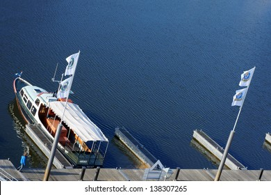 DA�MITZ, GERMANY � APRIL 01:  A boy goes along the footbridge of a ship jetty on April 01, 2013 in Damitz. The harbor is called also the gate to Mecklenburg-West Pomerania / At the pier