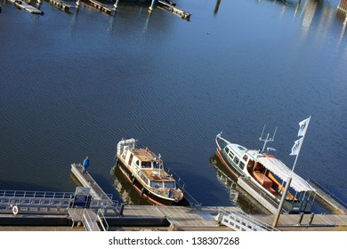 DA�MITZ, GERMANY â�� APRIL 01:  A boy stands on the footbridge of a ship jetty on April 01, 2013 in Damitz. The harbor called the gate to Mecklenburg-West Pomerania / Harbor D�¶mitz