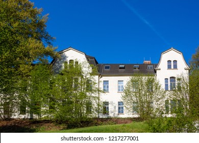 "Rösrath, Germany - April 16 2018: ""Haus Sommerberg"", an institution of the children, youth and family welfare. Operated by AWO (Arbeiterwohlfahrt,a national workers' welfare association in Germany)"