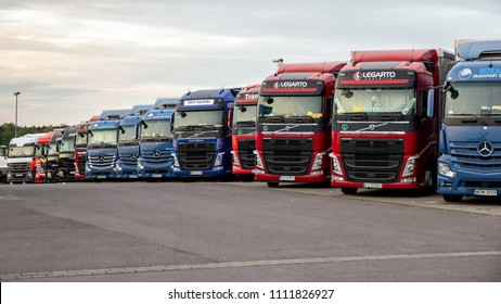 GERMANY - APRIL 28, 2018: Row of transport trucks on an overnight parking lot along the A2 highway in Germany.