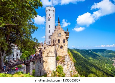 Germany - Aug 4, 2019: Lichtenstein Castle in summer. This beautiful castle is a landmark of Baden-Wurttemberg. Scenic view of magic Lichtenstein Castle on a cliff. Mountain landscape of Swabian Alps.