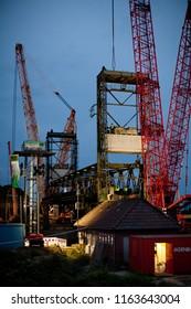 Huntebrück, Germany - August 24, 2018: big cranes next to the former historic Hunte brigde while deconstruction works at dawn