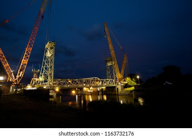 Huntebrück, Germany - August 24, 2018: deconstruction of the former technical monument, the historical Hunte bridge with two big cranes at night