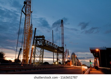 Huntebrück, Germany - August 24, 2018: the former technical monument Hunte bridge while deconstruction in front of beautiful dawn sky