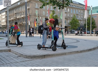 Düsseldorf, Germany - August 30, 2019: E-mobility in Germany: Inhabitants of Düsseldorf trying out electric scooters.