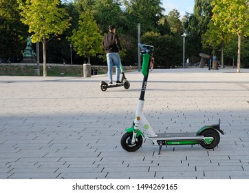 Düsseldorf, Germany - August 30, 2019: E-mobility in Germany: E-scooters waiting for customers next to a pedestrian road in Düsseldorf, Germany.