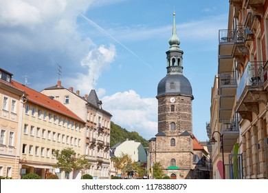GERMANY, BAD SCHANDAU - 26 JUNE 2018: old historical church of St John and buildings on street