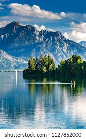 Germany, Bavaria, Allgaeu, Lake Forggensee with a couple standup paddling