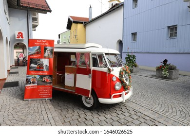 """GERMANY, BAVARIA, WAGING AM SEE - SEPTEMBER 22, 2019: The red and white VW bus """"Bulli Paul"""" can be rented for weddings and special tours"""