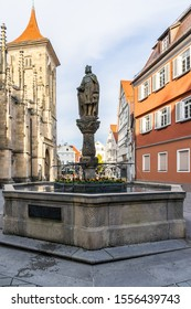 Germany, Beautiful waterspout fountain called church fountain, kirchbrunnen next to church of st mary, marienkirche in downtown marketplace