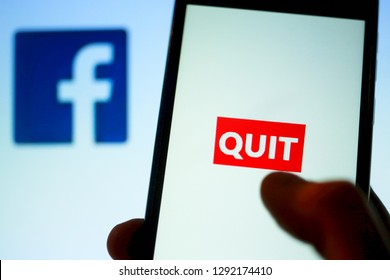 Germany, Berlin - 01/22/2018 Macro image close up of a thumb finger on white bright smartphone screen to quit with red button and deactivate Facebook account app. Delete due to data privacy issues